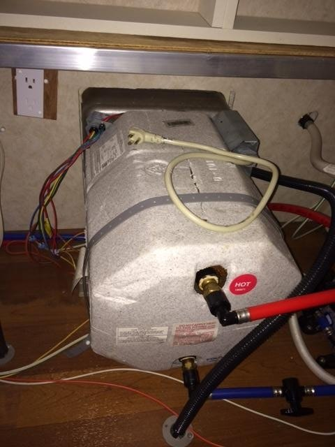 Plugging in 110V water heater element blows house GFI