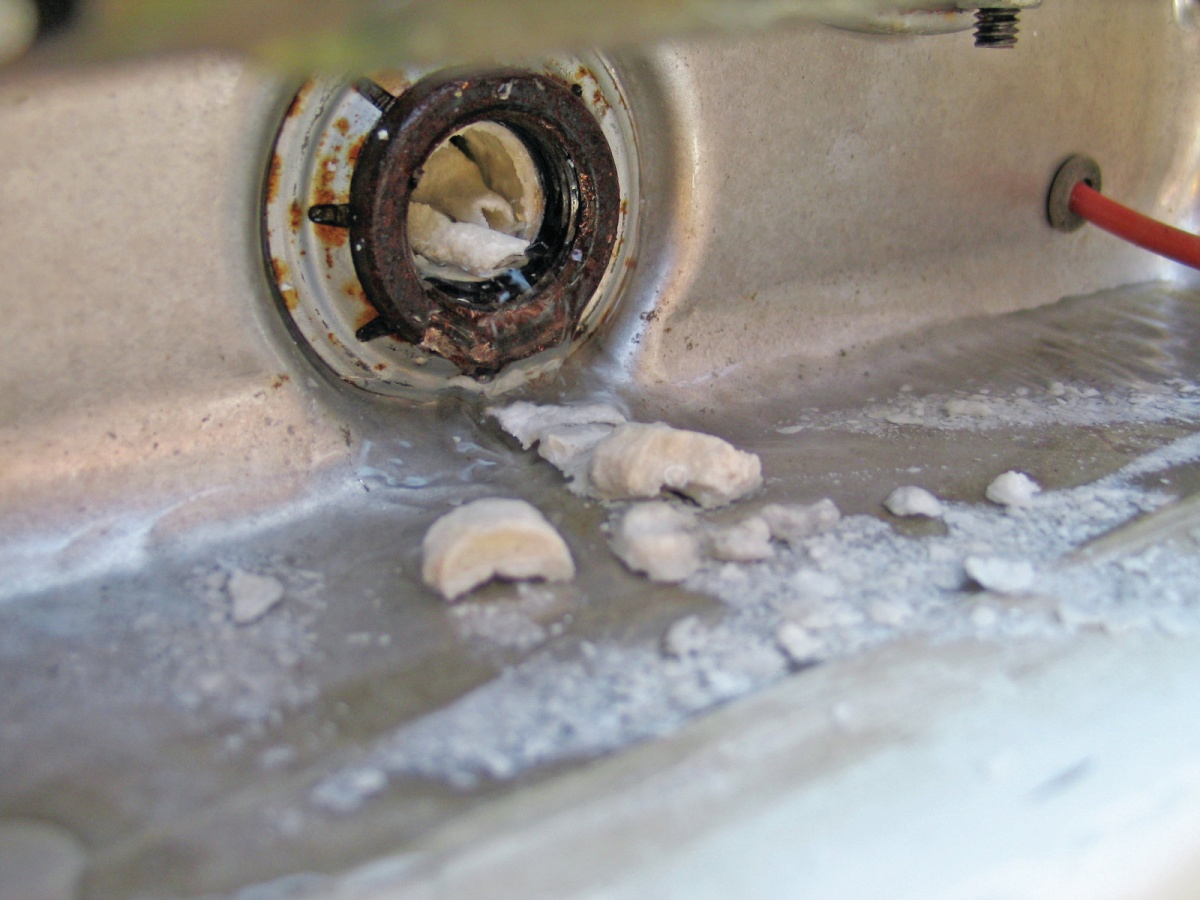 Click image for larger version  Name:keeping-the-water-hot-water-heater-maintenance-chunks-of-calcium.jpg Views:81 Size:259.3 KB ID:107129