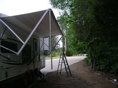 Click image for larger version  Name:Awning being retracted with poles.JPG Views:779 Size:90.6 KB ID:143540