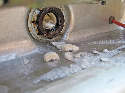 Click image for larger version  Name:keeping-the-water-hot-water-heater-maintenance-chunks-of-calcium.jpg Views:80 Size:259.3 KB ID:199696