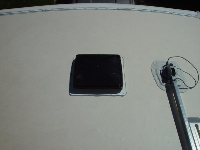 Click image for larger version  Name:fan installed and letting butyl tape oose out before lap sealant.jpg Views:107 Size:18.5 KB ID:29822