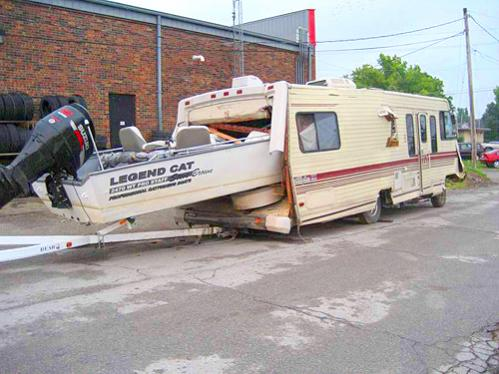 Click image for larger version  Name:1241578386-boat in camper.jpg Views:175 Size:37.6 KB ID:45759