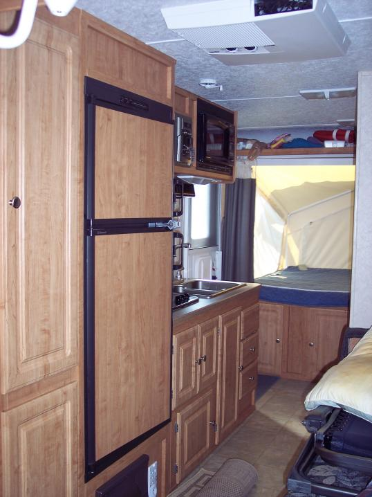 Click image for larger version  Name:Kiychen and rear bunk.jpg Views:108 Size:55.6 KB ID:4637