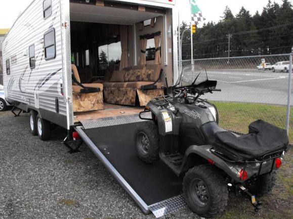 Click image for larger version  Name:Toyhauler with quad on ramp.jpg Views:121 Size:50.8 KB ID:9171