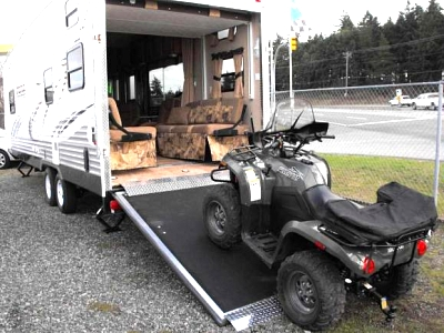 Click image for larger version  Name:Toyhauler with quad on ramp.jpg Views:185 Size:50.8 KB ID:9171