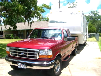 Click image for larger version  Name:7-31-11 F250 & trailer in our driveway we leave in the morning 001.jpg Views:53 Size:56.7 KB ID:9186
