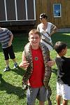 my brave son with a boa constrictor at reptile day