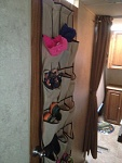 Over the door shoe rack for all the kids shoes.