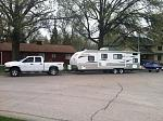 This is Duke, the truck and our previous Camper a 2013 grey wolf Cherokee 26DBH.