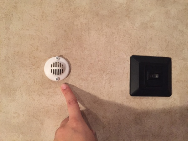 Small round vent above light switch.